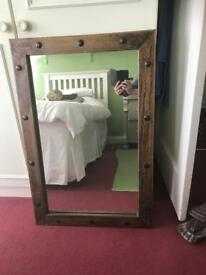 Dark wood framed large mirror with metal studs