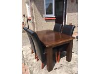 Dark wood table and 4 leather chairs