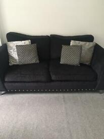 Black and Silver Studded Sofa