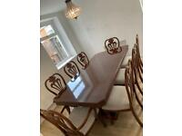 Solid Mahogany Dining Room Table with 8 Chairs in total which includes 2 end carvers