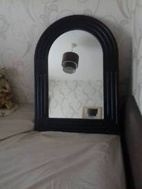 Arch shaped mirror in black frame 26 ins x 19 ins