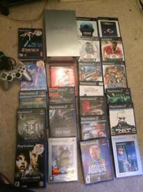 Sony silver ps2 console and various games
