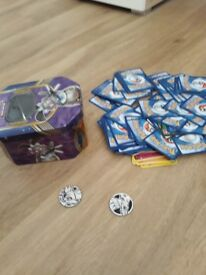 Pokemon tin with cards