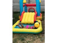 Bouncing castle slide and swimming pool