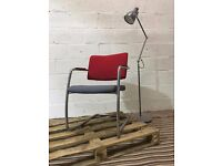 Dual coloured upholstered meeting chair with arms