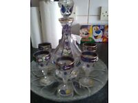 Lead crystal decanter and six glasses.