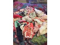 Black bag full of baby girl clothes 0-3 and 3-6 m