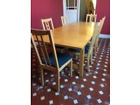 Extending dining table - seats 6-10