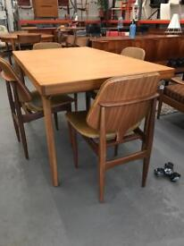 Mid Century Modern retro Danish Dining tables and sideboards.