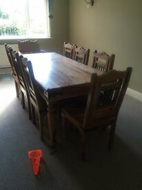 8 seater teak dining room table and chairs. 2000mm by 1000mm