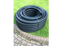 Perforated land drainage pipe