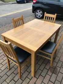 Extending kitchen table with 4 matching chairs