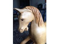 Hand carved traditional wooden rocking horse