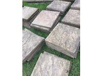 Patio paving slabs (59.5cm x 59.5cm), gold/sand colour.