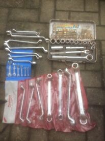 Mixture of ring and open ended spanners and insulated mole grips some new