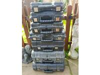 Various empty dewalt tool cases