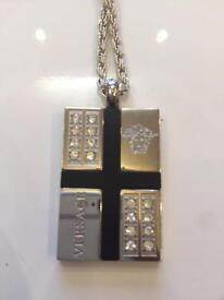 VERSACE TAG CHAIN. IN EXCELLENT CONDITION