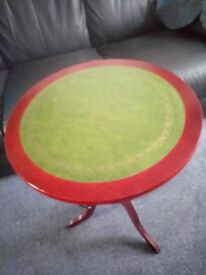 A CIRCULAR GREEN TOPPED SIDE TABLE WITH DRAW