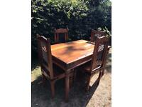 Sheesham dining table and 4 chairs in good condition