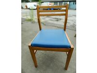 two hundred vintage teak dining chairs from an RAF base to clear