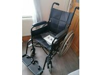 Invacare wheelchair with self propelled wheels