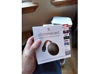 Chrome cast in box with wires.
