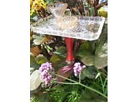Steel pole with glass bowls Bird Baths and/or feeders