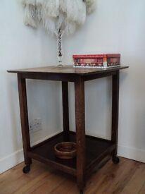 "Vintage table (21""Lx21""Wx26""H approx) Suitable for upscaling. Nifty antique castors!"