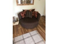 Great condition swivel love armchair
