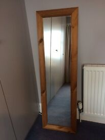 Tall wooden framed mirror
