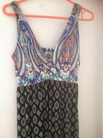 Ladies maxi dress size 12-14 does stretch to 16/18
