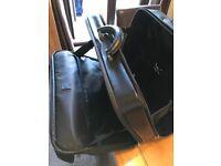 TRIPP Pilots Case. Good condition. Extendable carry handle. Wheels.