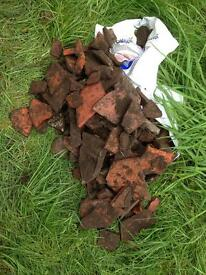 Free broken roof tiles for plant pot drainage