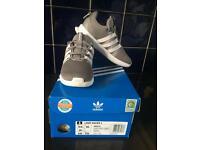 Kids grey adidas trainers size 9