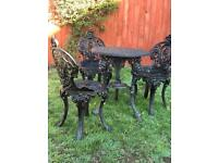 Vintage cast iron garden table and four chairs
