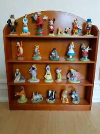 A selection of Grolier Disney china characters with shelving unit