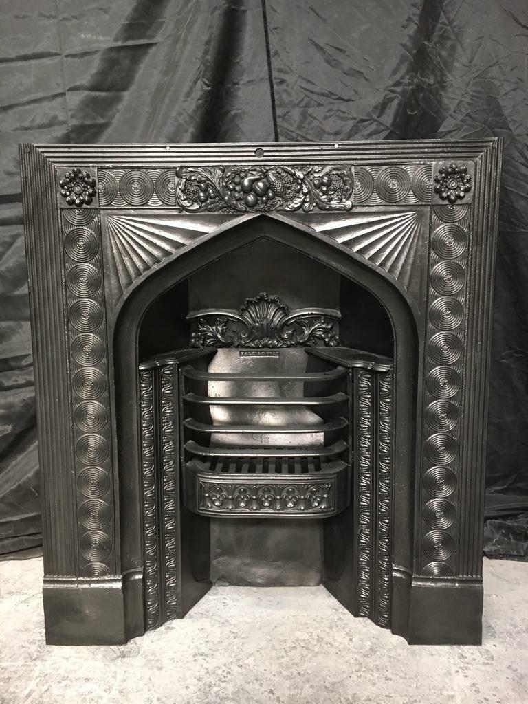 A rare and unusual l gothic shaped Georgian cast iron insert