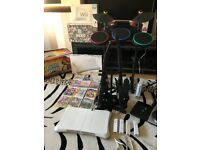 Nintendo Wii Bundle Wii with 4 Controllers, Wii Fit, Guitar Hero Guitars, Drums, Just Dance and MORE