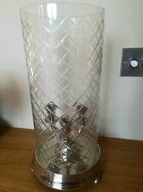 Candle holder with glass suround