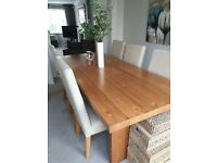 Dining table with six leather chairs