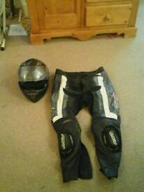 Mens motorbike leather trousers and carbon fibre style helmet