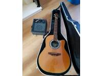 Acoustic roundback Encore Guitar with amp.