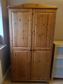Pine wardrobe and chest of drawers.