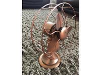 Quirky metal decorative fan