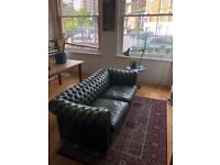 Real leather worn in, vintage dark green Chesterfield style sofa