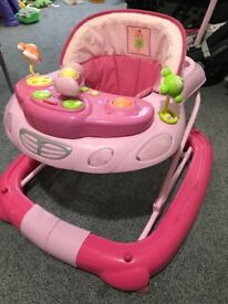 Pink baby walker with activity tray