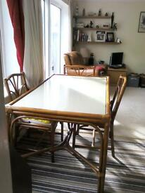 Good looking set of dining table, glass topped and 6 chairs.