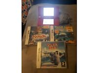 Pink dsi console with games