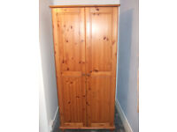 Two identical single wardrobes and a matching chest of draws