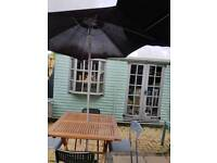 Square wood table 4 chairs parasol